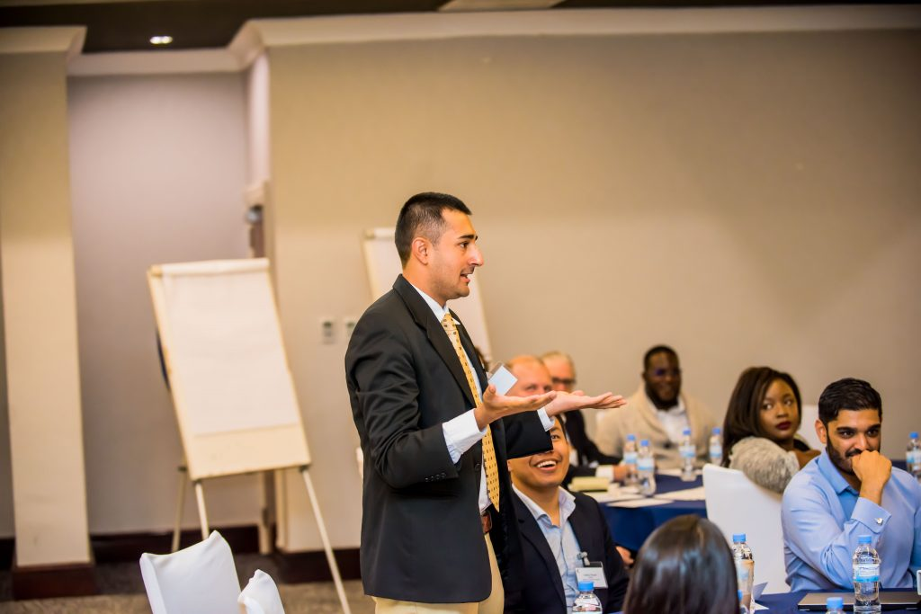 Lawyer presenting in front of participants at the Oxford Policy Fellowship Annual Meeting